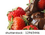 Strawberries dripping with melted dark chocolate.  A delicious indulgent treat. - stock photo