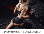 sports woman turns over tire... | Shutterstock . vector #1296609310