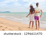 back view of couple sitting on... | Shutterstock . vector #1296611470