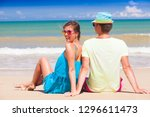 back view of couple sitting on... | Shutterstock . vector #1296611473