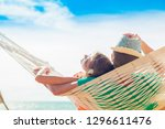 young couple in love relaxing... | Shutterstock . vector #1296611476