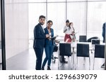 african female intern talking... | Shutterstock . vector #1296639079