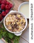 granola in bowl for breakfast | Shutterstock . vector #1296649369