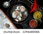 baked potatoes in salt on cast... | Shutterstock . vector #1296680086