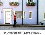 man walking by beautiful... | Shutterstock . vector #1296690310