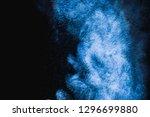 blue powder explosion on black...   Shutterstock . vector #1296699880