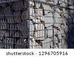 stone gabion wall | Shutterstock . vector #1296705916