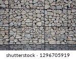 stone gabion wall | Shutterstock . vector #1296705919
