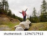 cute little boy walks in swiss... | Shutterstock . vector #1296717913