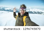 Handsome funny skier is taking...