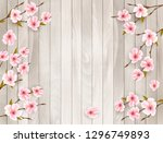 cherry branch with a pink... | Shutterstock .eps vector #1296749893