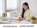 asian female freelancer reading ... | Shutterstock . vector #1296765499