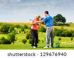 Young Female Golf Player At...