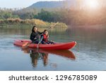 mother and daughter rowing boat ... | Shutterstock . vector #1296785089