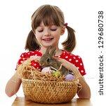 happy little girl with easter... | Shutterstock . vector #129680738