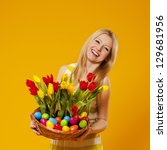 Happy Woman Holding Basket Wit...