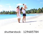 young beautiful family with two ... | Shutterstock . vector #129685784