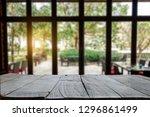 empty top of wooden shelves on... | Shutterstock . vector #1296861499
