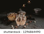 homemade muffins with chocolate ... | Shutterstock . vector #1296864490