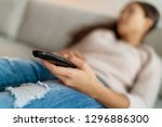 watching tv bored woman tired... | Shutterstock . vector #1296886300