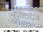 glass for champagne and wineglass in row on table, side perspective view stock photo image