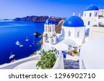 Oia, Santorini, Greece, famous whitewashed village with cobbled streets, Greek Cyclades Islands at Aegean Sea
