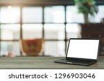 laptop blank screen on wooden... | Shutterstock . vector #1296903046
