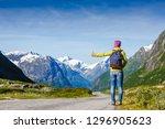 hitchhiker hipster girl walking ... | Shutterstock . vector #1296905623