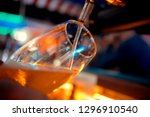 close up of barman hand at beer ... | Shutterstock . vector #1296910540