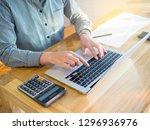 business women typing on... | Shutterstock . vector #1296936976