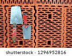 trowels on a red brick. masonry ... | Shutterstock . vector #1296952816