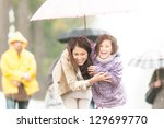 happy mother and daughter... | Shutterstock . vector #129699770
