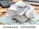 crumpled tax form with money ...   Shutterstock . vector #1297025086