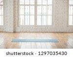 unrolled yoga mat lying in... | Shutterstock . vector #1297035430