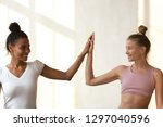two multiracial sportive girls... | Shutterstock . vector #1297040596