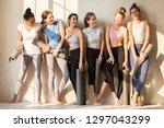 toned multiracial girls stand... | Shutterstock . vector #1297043299