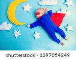 little baby superhero with red... | Shutterstock . vector #1297054249