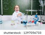 funny little girl doing... | Shutterstock . vector #1297056733