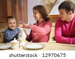 parents with son at tea | Shutterstock . vector #12970675
