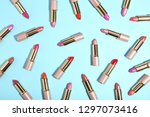 many colorful lipstick on blue... | Shutterstock . vector #1297073416