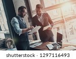 team of innovators. two young... | Shutterstock . vector #1297116493