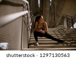 young fitness woman doing... | Shutterstock . vector #1297130563