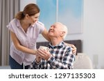 elderly man with cup of tea... | Shutterstock . vector #1297135303