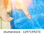 beautiful legs of a girl near a ... | Shutterstock . vector #1297159273