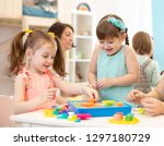 happy children playing with... | Shutterstock . vector #1297180729