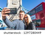 happy couple tourists taking... | Shutterstock . vector #1297280449