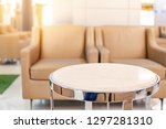table and sofa in waiting area... | Shutterstock . vector #1297281310