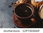 cup with hot coffee  muffins... | Shutterstock . vector #1297303069