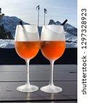 two aperol spritz cocktails in... | Shutterstock . vector #1297328923