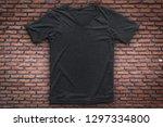 grey t shirt on brick wall... | Shutterstock . vector #1297334800